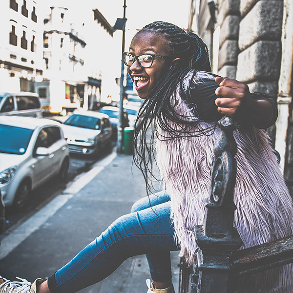 girl-sitting-happy-with-braids-and-glasses-fursa-africa